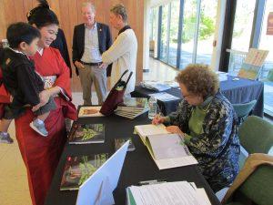 Signing a book at Aki Matsuri!